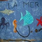 La mer (peinture à l'éponge + animaux coloriés + sable)